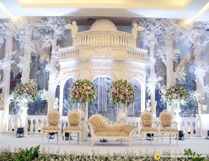 Jon and Melinda's wedding reception | Venue at Vida Ballroom Jakarta | Decoration by Grasida Decor | Cake by Justin Cake Jakarta | Catering by Adhika Catering Jakarta | Bridal shoes by Rina Thang | Lighting by Lightworks