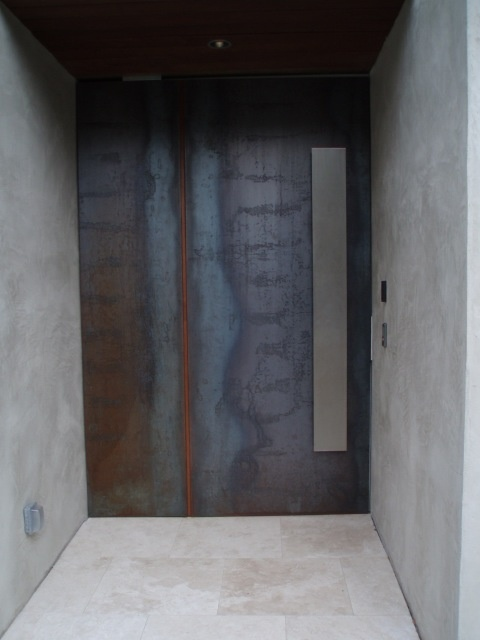 corten steel door concrete wall stainless steel handle