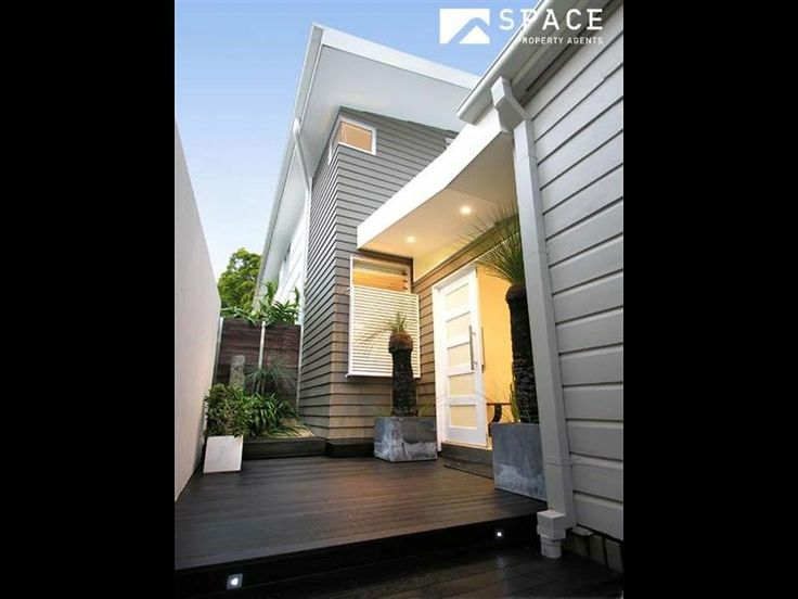 Renovated Queenslander workers cottage - the entry is at the side between the old & new.