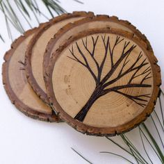 Set of 4 Rustic Wood Slice Coasters with Wood Burned Tree Designs on Etsy, $35.00