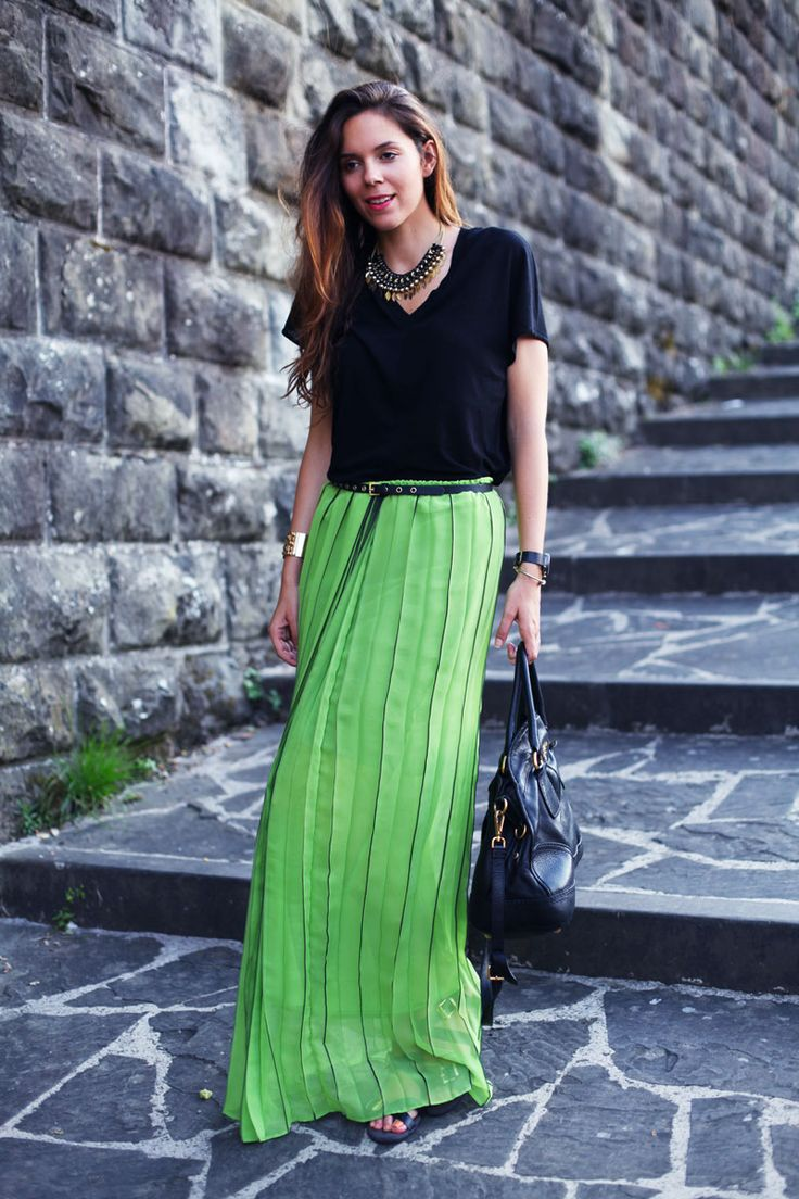 A colour pop green skirt with black t shirt, a black Prada bag and a sparkly necklace
