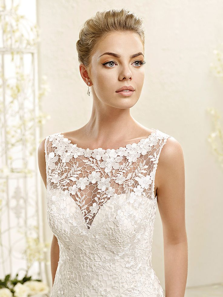 ADK Style 77972  Fabric: Soft tulle over sparkling tulle skirt / Corded chantilly lace appliqués