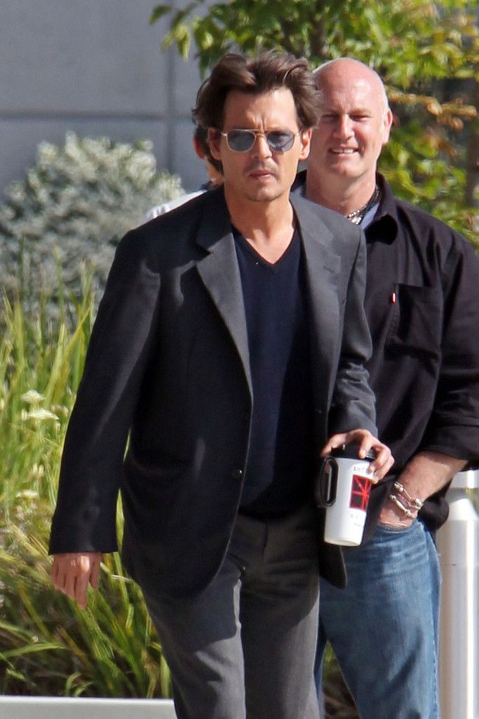 This one's for Krista...Johnny Depp Takes a Coffee Break on Set. :-)