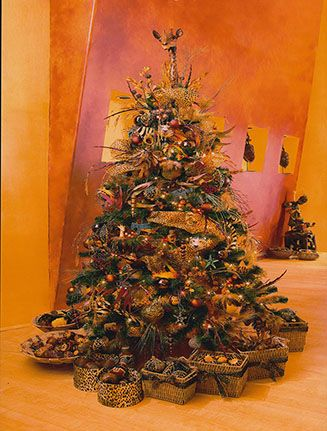 African Christmas tree. I love the baskets as an alternative to stockings. A tree skirt in an African pattern would totally complete the look.