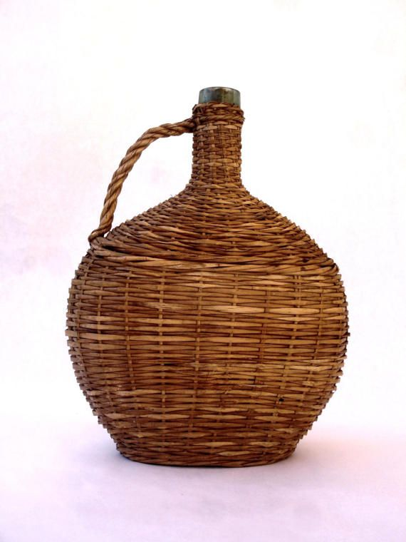 Retro disc shaped bottle covered with wicker weave - vintage item from the 1960s