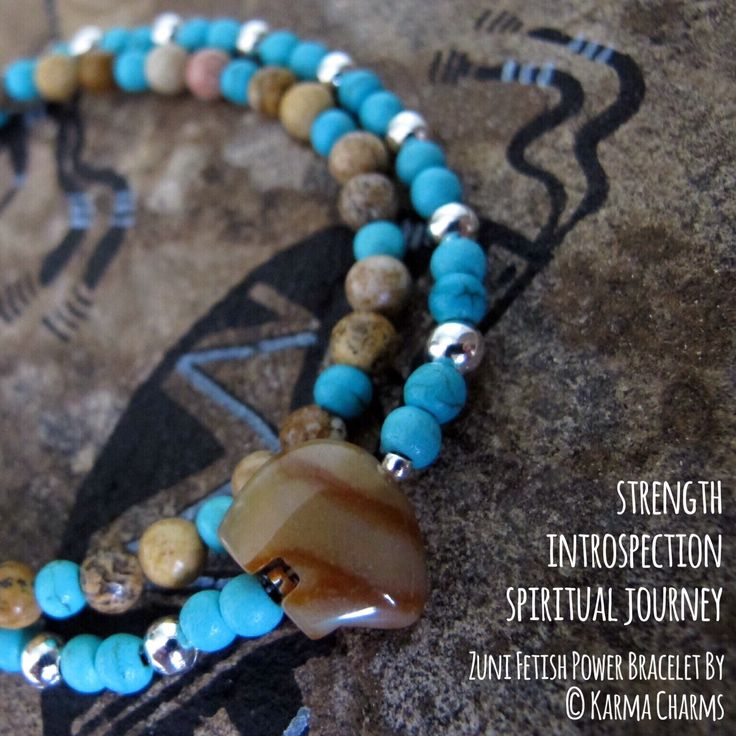 Zuni bear fetish made of natural Carnelian combined with 4mm Turqoise howlite and Picture Jaspis into a wrap bracelet. The Zuni fetish stands for strength, introspection, spiritual journey through life. Carnelian is good for balancing body energy levels. #bracelets #beads #handmade #jaspis #healingstones #handmadejewelry #zuni #bear #fetish #oneofakind #power #semipreciousstones #semiprecious #stones #turquois #carnelian #cornelian #picturejaspis #protection #spiritual #journey…
