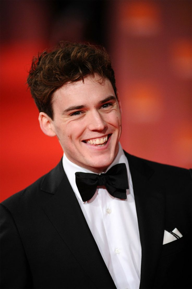 Sam calfin (finnick) he is very good looking.... Also he is British