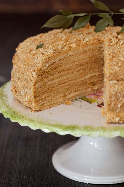 Russian honey cake, Medovnik. Do not be fooled by the beautiful photography of this website; this recipe was a disaster. From unclear directions about double-boiling to using TWO STICKS of butter for the cream, I ended up conjoining this recipe with elements of the better Natasha's Kitchen recipe (which unfortunately used other ingredients).  The result still came out delicious and picturesque, but I would not recommend this recipe. Use Natasha's Kitchen recipe, for SURE.
