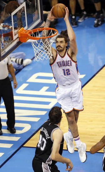 Oklahoma City's Steven Adams (12) goes up for a dunk over San Antonio's Boban Marjanovic (40) during Game 6 of the Western Conference semifinals between the Oklahoma City Thunder and the San Antonio Spurs in the NBA playoffs at Chesapeake Energy Arena in Oklahoma City, Thursday, May 12, 2016. Photo by Sarah Phipps, The Oklahoman