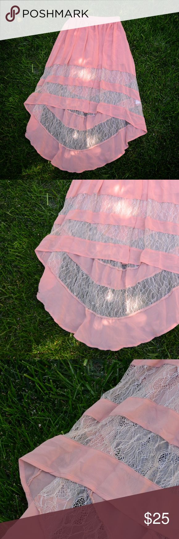 Asymmetrical Lace Skirt Cute Lace peek throughs on this high low design skirt has zip up side enclosure and compliments an array of outfits! Perfect for the casual or business casual look, day out, picnic, shopping, party, date night etc! Peach pink, pastel pink, cream lace Skirts High Low