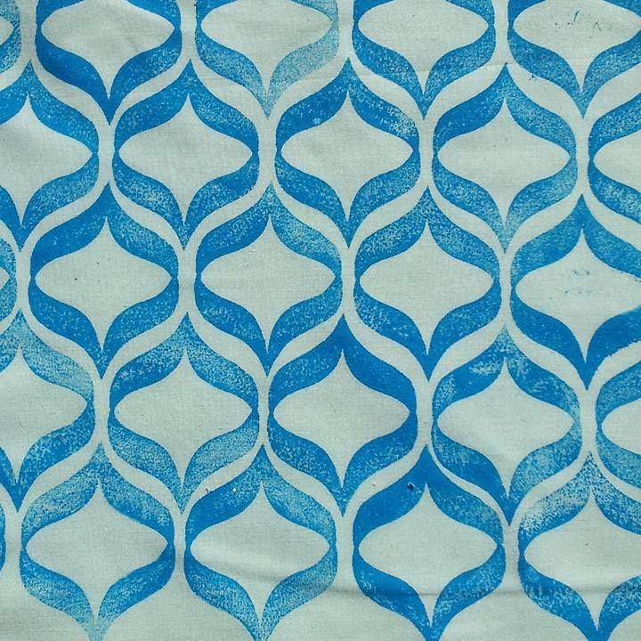 repeat pattern. single hand carved stamp, permaset aqua ink, cotton poplin fabric
