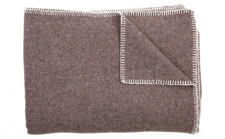 Our eco- friendly Recycled Throw is made at a Minnesota woolen mill that has been producing fine quality goods since 1865. A recycled wool blend gives the throw its unique heathered grey look and texture. The addition of recycled acrylic makes for a softer hand in addition to keeping acrylic fibers out of landfill. Our Recycled Throw is finished with a contrasting white whipstitch.		    •65% recycled wool / 35% recycled acrylic  •heathered grey look and texture  •contrasting white…