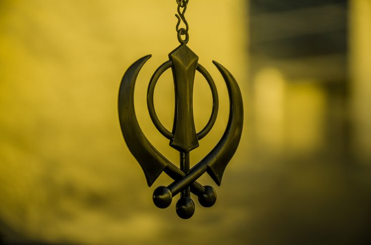 Khanda - The Khanda is the symbol of the Sikhs, as the Cross is to Christians or the Star of David is to Jews. It reflects some of the fundamental concepts of Sikhism. The symbol derives its name from the double-edged sword (also called a Khanda) which appears at the center of the logo. This double-edged sword is a metaphor of Divine Knowledge, its sharp edges cleaving Truth from Falsehood. The circle around the Khanda is the Chakar. The Chakar being a circle without a beginning or an end…