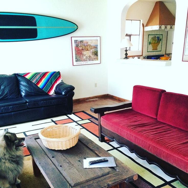 Living room next door sorted...love Larry's surfboard on the wall! by mirandaash