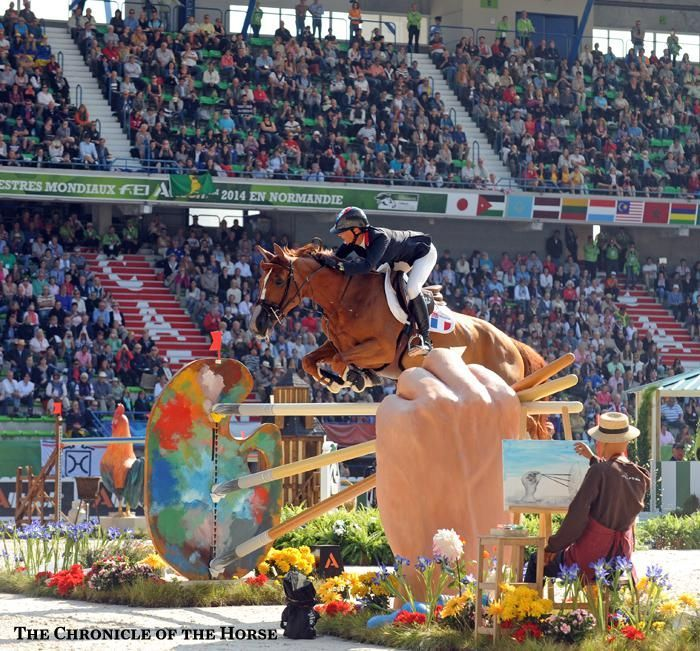 2014 Alltech FEI World Equestrian Games Show Jumping Nations Cup Day 1  Penelope Leprevost and Flora de Mariposa  Photo by Mollie Bailey  | The Chronicle of the Horse