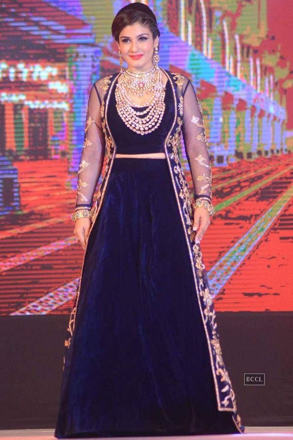 Bollywood Actress Saree Collections: Raveena Tandan in Navy Blue Velvet Lehenga Choli with Long Jacket at IBJA Fashion Show