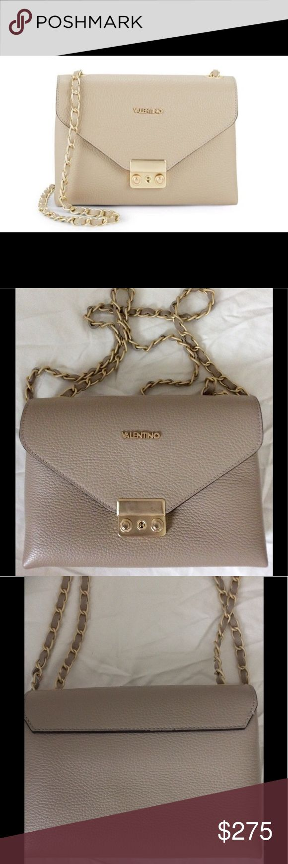 "Valentino by Mario Valentino Crossbody Handbag NWT BRAND NEW WITH TAGS, CARE CARD & DUST BAG.....MSRP $745.00...SOLD OUT IN STORES EVERYWHERE❗️ Details: A chic crossbody bag for stylish on-the-go wear Crossbody strap, 21"" drop Front flap with push-lock closure Two inside slip pockets One inside zip pocket Goldtone metal hardware Includes dust bag Fabric lining 9"" W X 6"" H X 2.5"" D Dove Gray Genuine Leather Made in Italy Style code: 0400095349365 Mario Valentino Bags Crossbody Bags"