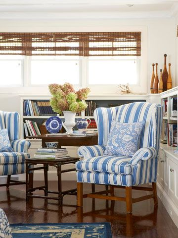 A wing chair upholstered in a playful stripe adds a punch of color to this space.