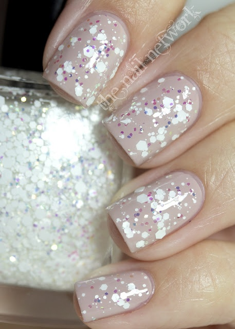White sparkles over nude polish- Wintery!