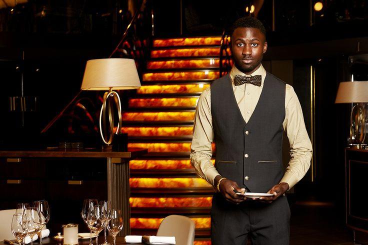 The Quaglino's waiter in his Studio 104 uniform.