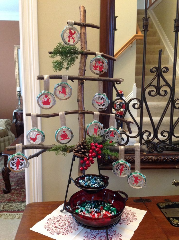 12 days of Christmas out of jar lids, paper cuts and tree branches