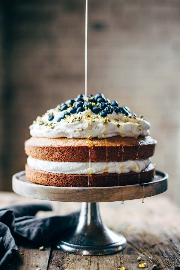 Orange Brunch Cake - SUPER YUMMY because it's made with olive oil and whole oranges! topped with whipped cream and blueberries and you're in fancy brunch business. food photography, food styling, cake photography