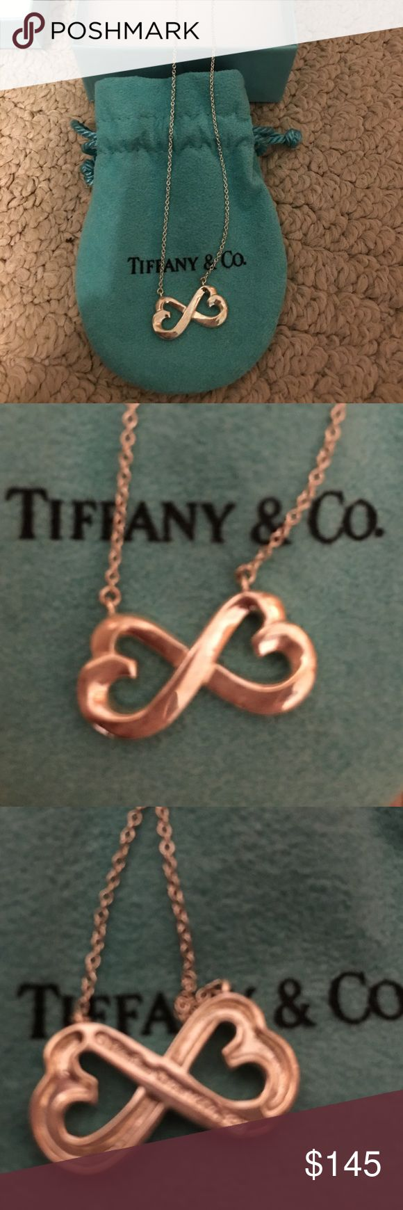 Tiffany Double heart necklace This is 100 % authentic double heart necklace, in great condition.  Only worn once.  Comes with original blue pouch and box. Tiffany & Co. Jewelry Necklaces