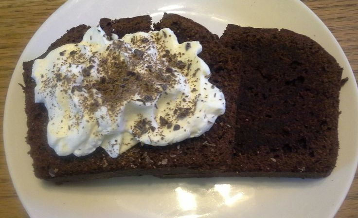 Sour cream and dark chocolate bread topped with fresh cream