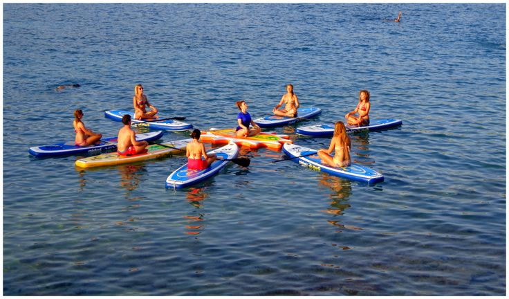 Evening class right before sunset with Nefeli Stamouli at Loutraki beach, Chania Crete on our Mistral boards.  http://paddleboardyoga.net/