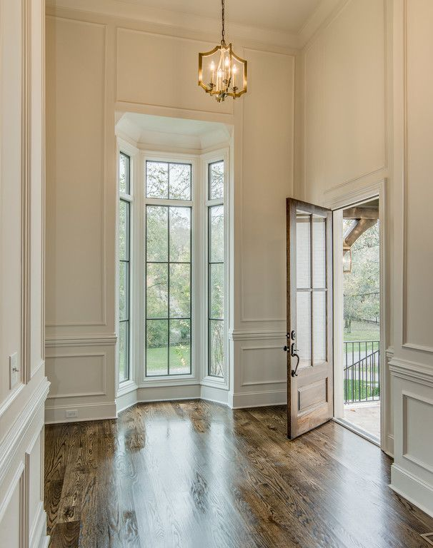 moldings & wainscoting, tall bay window, cream color, white on white paint