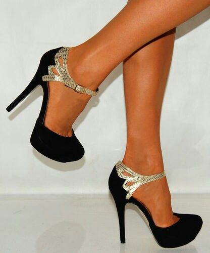 I don't wear extremely high heels much anymore, and to be honest most of them are no longer pretty to me since the feet wearing them look unattractively uncomfortable...however, these pair don't look painfully high, and are tres elegant. Yummy!
