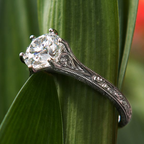 his hand-engraved platinum and diamond engagement ring is incredibly delicate – and with tiny little hand fabricated feathers in the side panels, unbelievably detailed. For many jewelers at Green Lake, working on this scale is where serious skills are required and serious talent proven. Go small or go home.