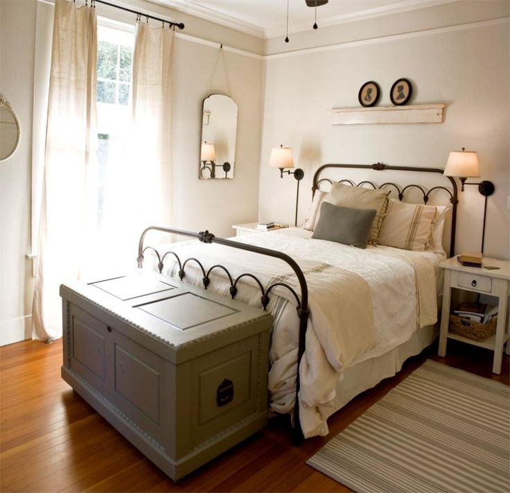 a light and bright setting is enhanced with a dark iron bed for contrast country bedroom decorationscountry style bedroomsbedroom romanticvictorian