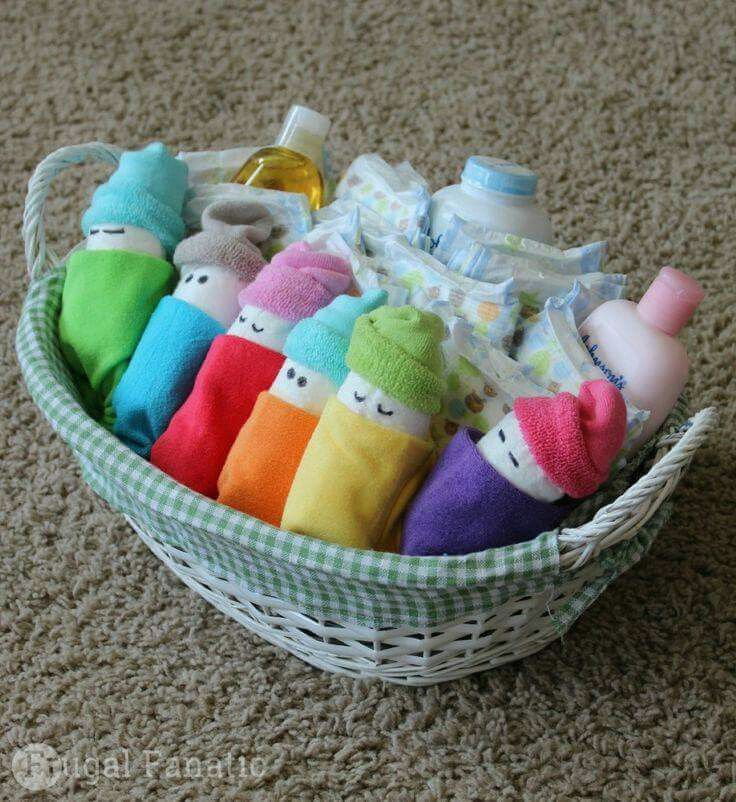 A little diaper, socks and a cloth with bath time stuff basket