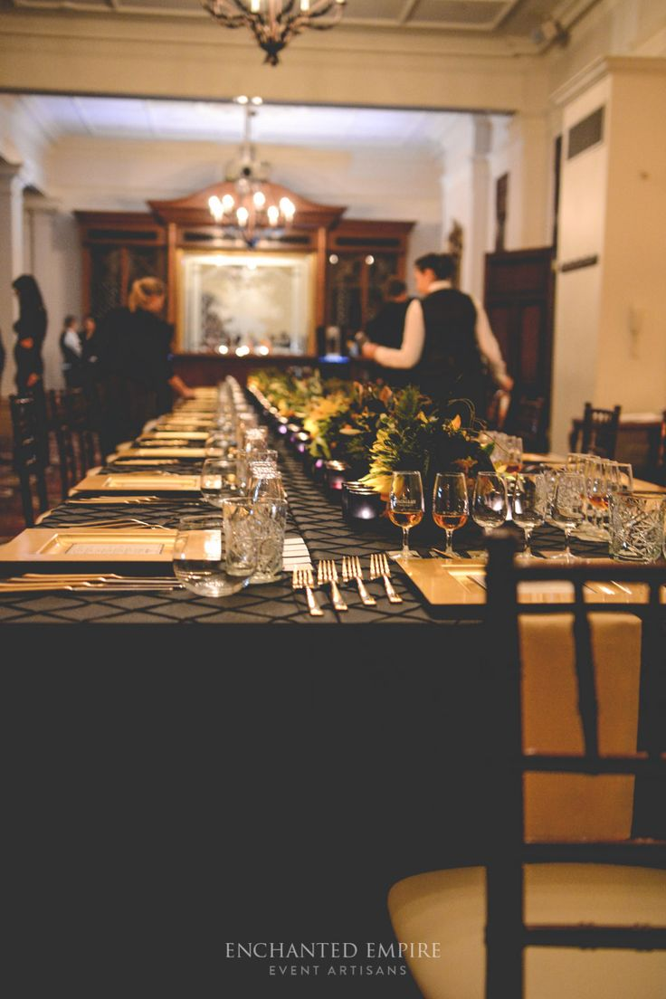Set in the beautiful Treasury Casino + Heritage Hotel, the banquet table was dressed in decadent black pintuck tablecloth with sculpted rustic florals to compliment the branding of The Macallan Whisky. Frosted black tealight votives illuminated golden cutlery and charger plates, with complimenting whisky cards to match each course. Custom branded linen napkins enhanced the styling and brought in the Mahogany Tiffany Chairs perfectly…