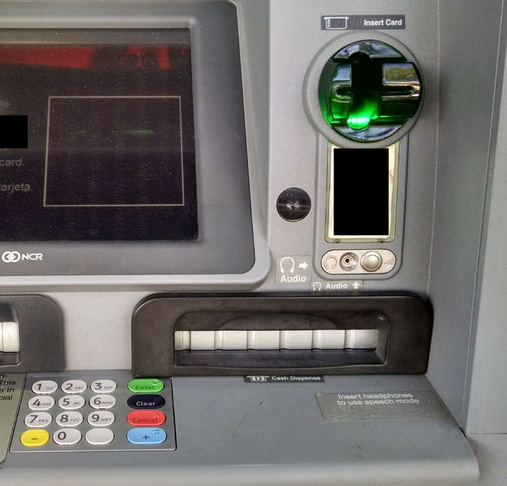 Why I Always Tug on the ATM - Although it's difficult to tell from even this close, this ATM's card acceptance slot and cash dispenser are both compromised by skimming devices.