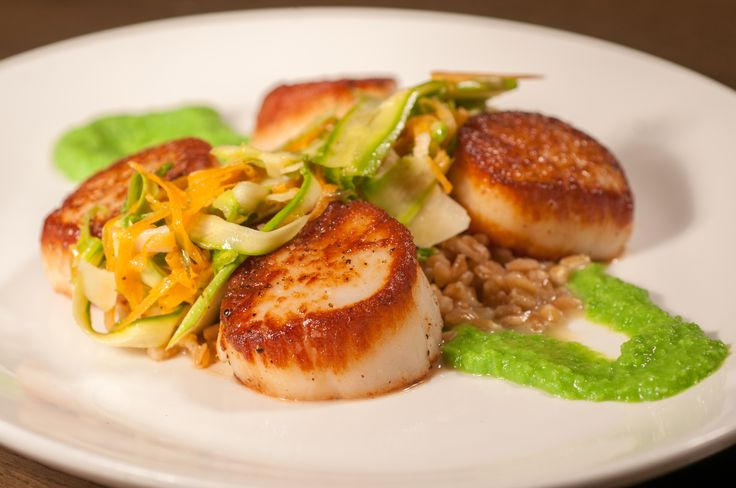 PAN-ROASTED SEA SCALLOPS pea purée, shaved asparagus salad, lime-scented farro  www.TheAtlanticGrille.com