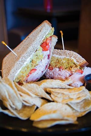 Gobble up Cosmo's delicious turkey sandwich every day of the year. The Thanksgiving-themed sandwich includes smoked turkey, cream cheese and cranberry relish topped with hot stuffing and...