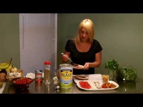 Video - Pita Pizza Recipe & Cooking Video-This quick and flavorful weeknight meal is fun and easy to assemble. Make dinner easy and assemble them using pre-made & frozen PD gluten-free Oat Flour Flat Bread. You can have pita pizza assembled and on your table faster than greasy overpriced delivery. Have your kids make their own personal pizzas and show them just how delicious healthy pizza can be.(Affiliate) https://protectivediet.com/recipe/pita-pizza?affiliate=7