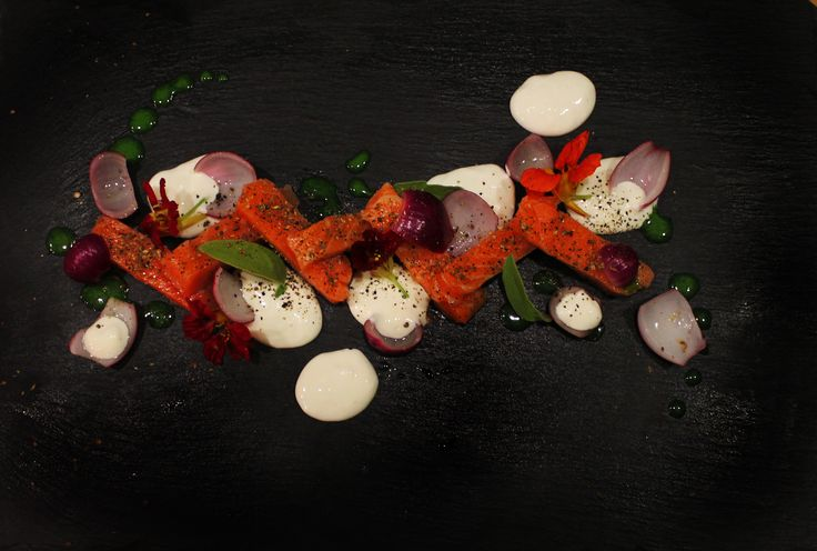 Salmon sous vide with horseradish sauce and pickled onions - top view