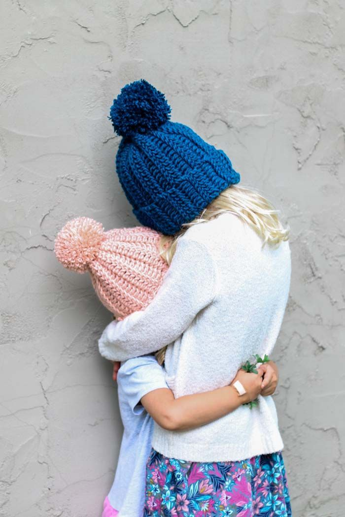 Easy child s crochet hat pattern with a pom pom on two kids hugging. Free  pattern and tutorial for children 0090fefc30a