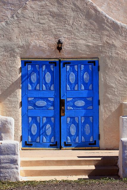 Vibrant blue church doors. New Mexico