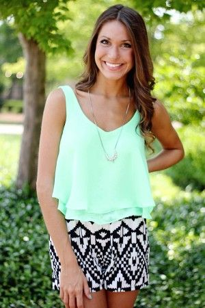 The cutest outfit for summer just hit ellieclothing.com! Aztec print shorts with our neon green crop top. Adorable!
