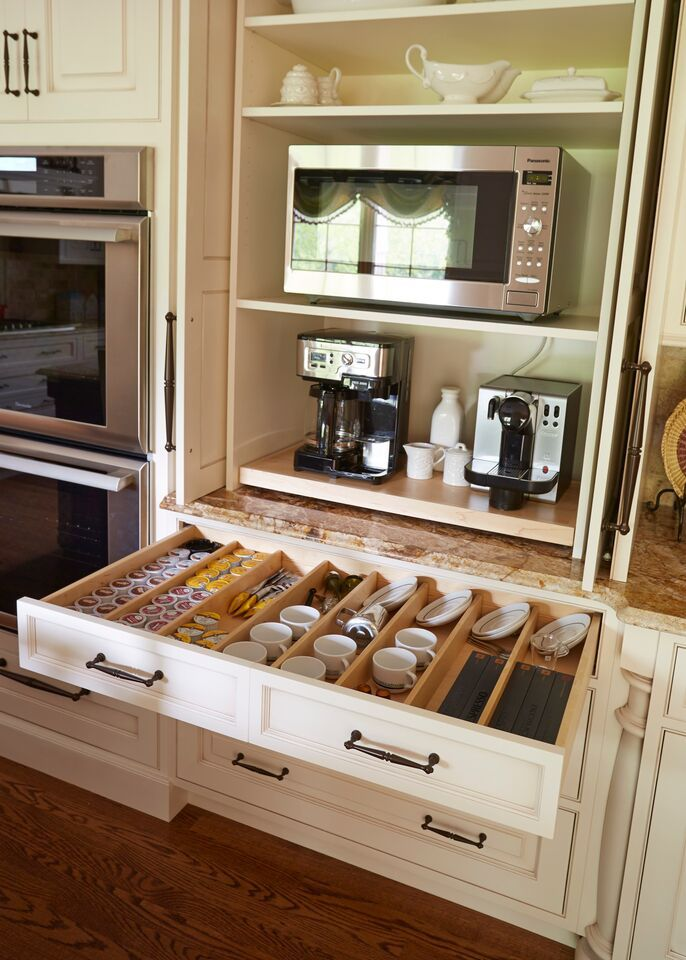 This is truly awesome. Who wouldn't love their very own HIDDEN coffee station?! #kitchenremodeling www.homesheart.net