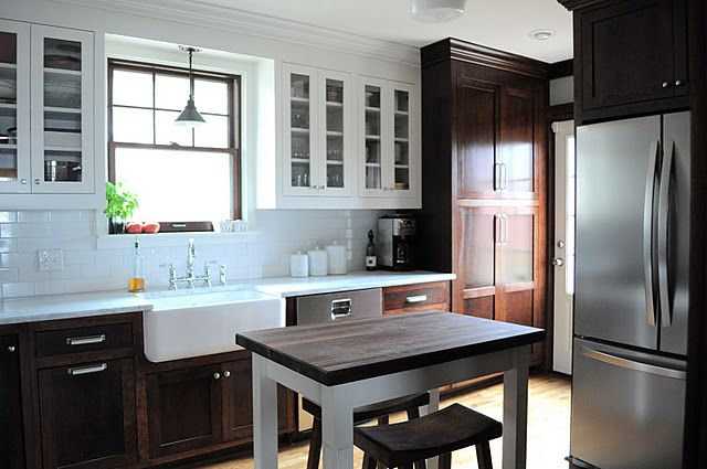 Love the dark wood cabinets on the bottom with white on top. Farm sink!