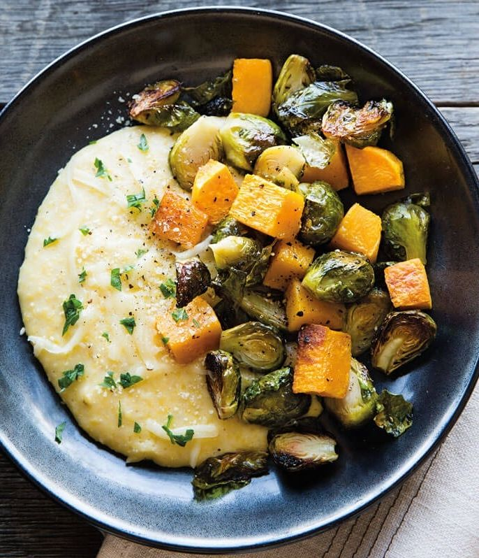 Cheesy Polenta with Roasted Vegetables | A warm bowl of creamy polenta is about as comforting as it gets, which makes it a great foundation for a meatless Monday meal.
