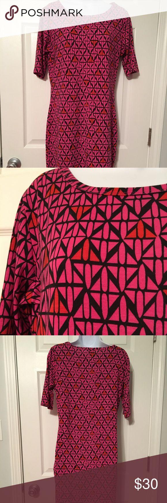 Nwot LuLaRoe Julia size M Beautiful pattern on this LuLaRoe Julia dress. New without tags. Never worn. Love LuLaRoe! Size M, size 10. This dress is a fitted dress. LuLaRoe Dresses