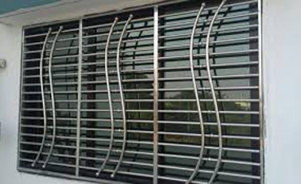Safety Doors Desigen In Pune Metal Safety Doors In Pune How To Choose The Best Window Grille For Y Balcony Grill Design Window Grill Design Steel Grill Design