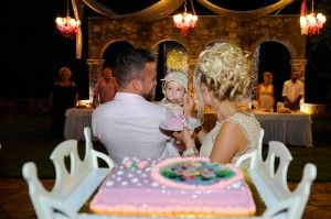 Lovely photo of little girl with her proud parents - sweet christening cake -Location Ktima Tritsimpida Greece - Summer Night - Photography Con Tsioukis - ICON PHOTOGRAPHY MELBOURNE - www.iconphotos.com.au