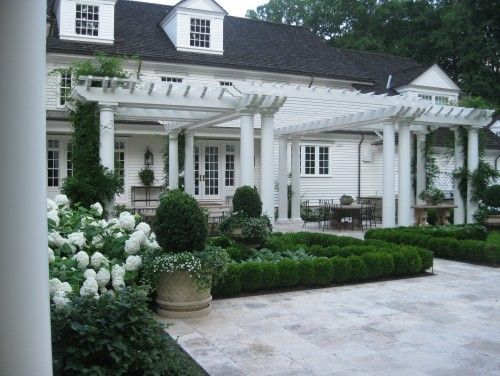 boxwood hedge, planters, and white flowers - March | 2012 | KARNAS HUS